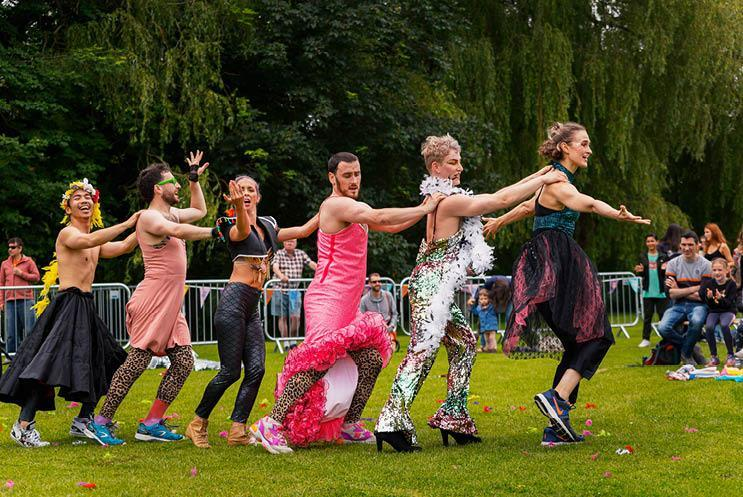 performers doing a conga line