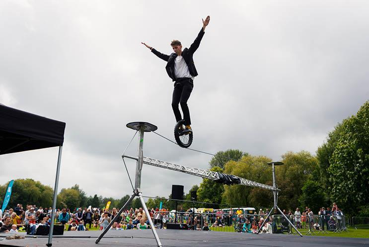 man on unicycle on high wire