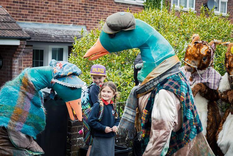 kids talking to ducks